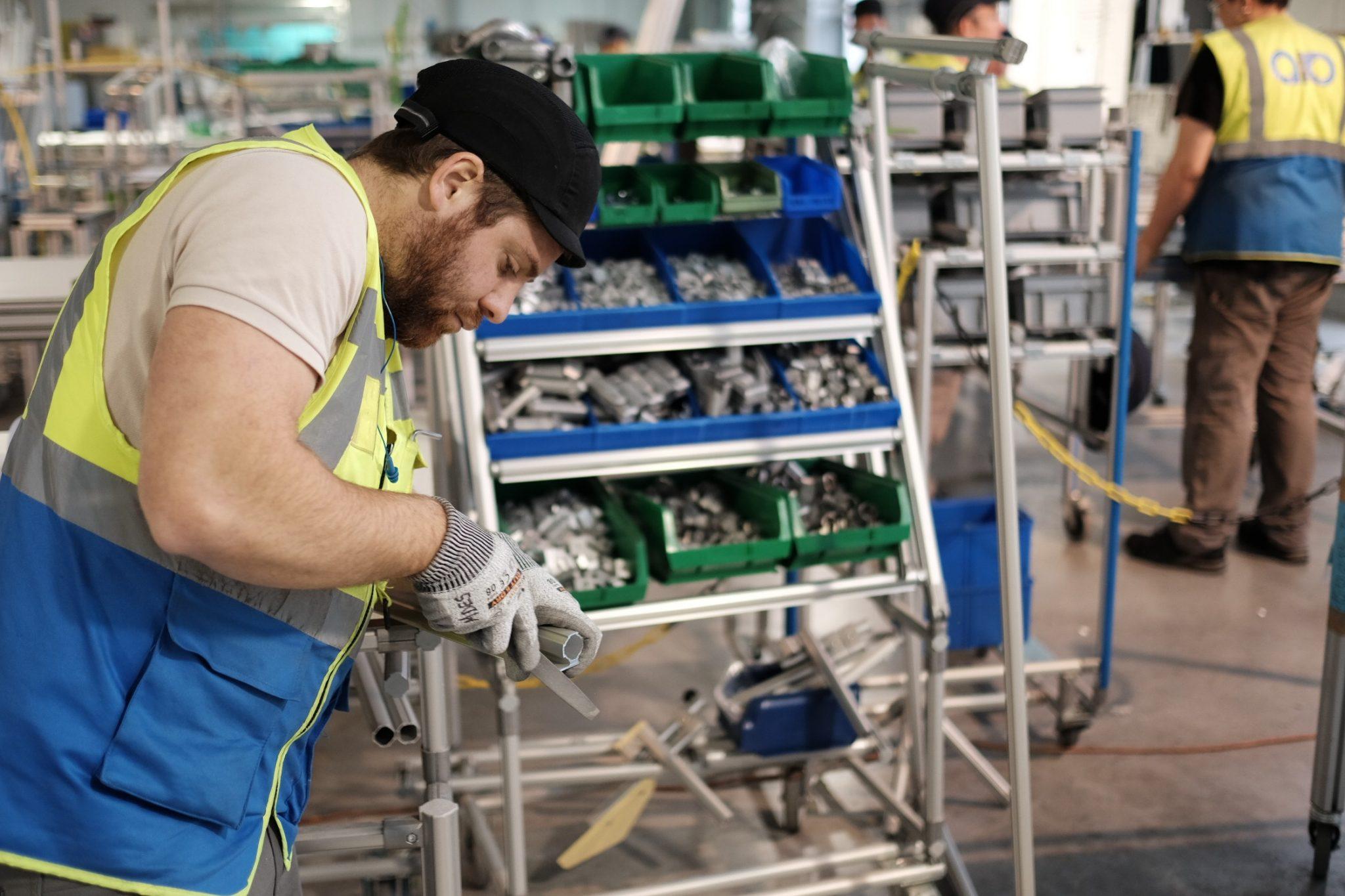 Man working in a factory with lean and kaizen Karakuri Kaizen